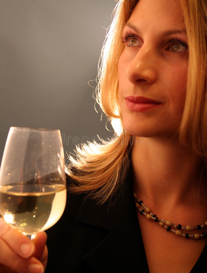 Attractive woman drinking wine. royalty free stock image