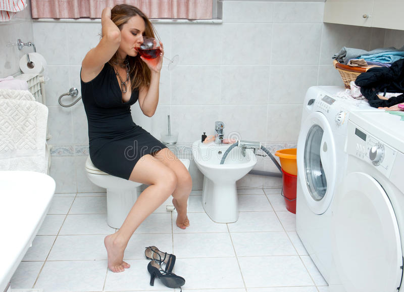 Attractive woman drunk in her bathroom royalty free stock photos