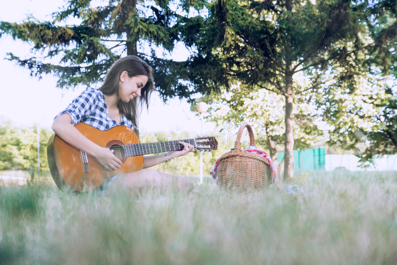 Attractive woman enjoys playing her favourite instrument stock photo