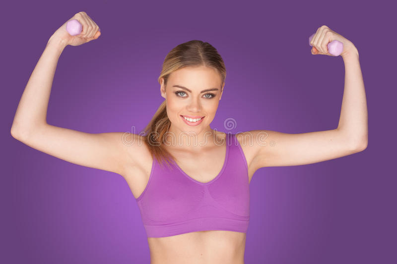 Attractive woman exercising with dumbbell royalty free stock photos