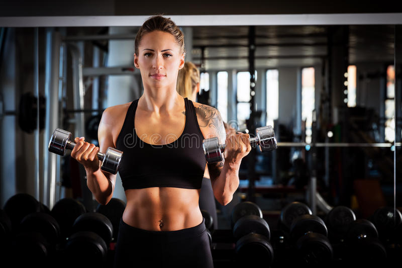 Attractive woman exercising at the gym. stock images