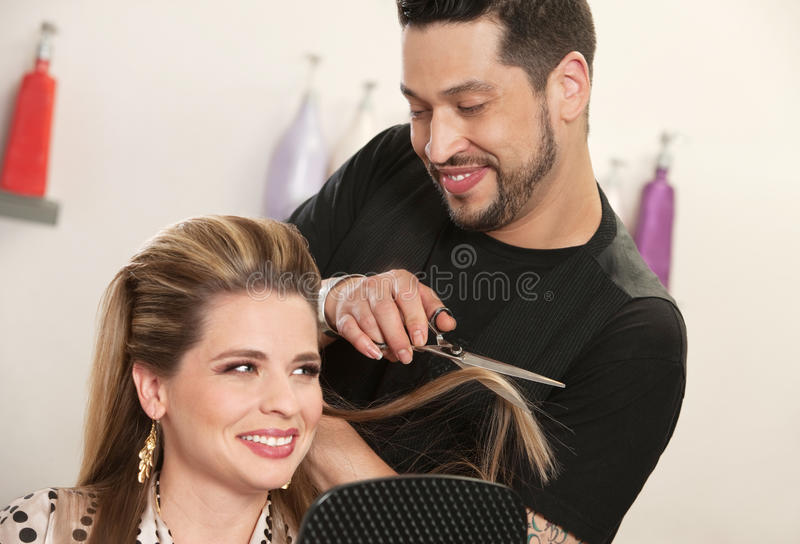 Attractive Woman Getting Haircut royalty free stock photography