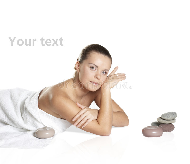 Attractive woman getting spa treatment isolated. The perfect woman about aromatic candles royalty free stock image