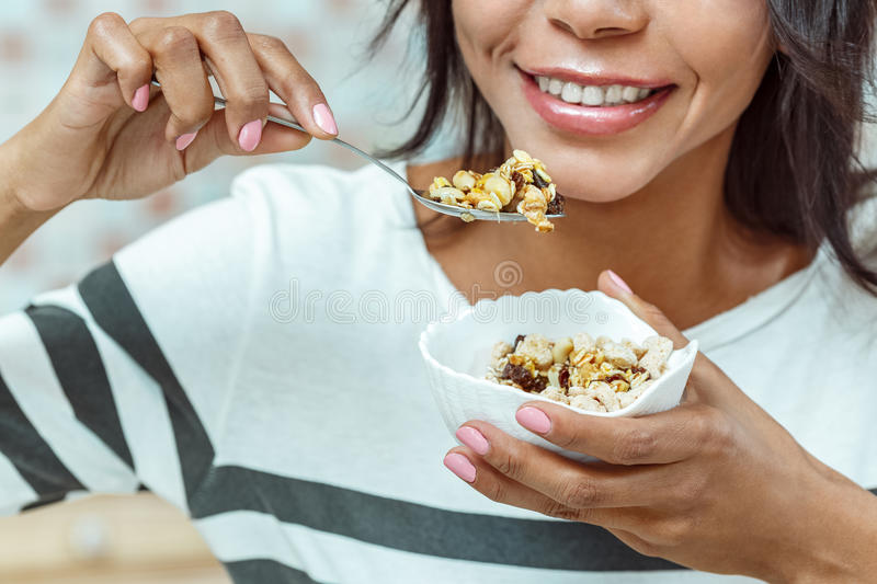 Attractive woman having breakfast in a kitchen royalty free stock photos