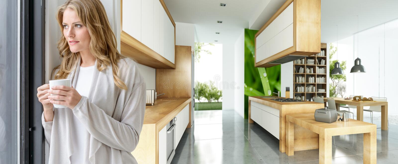 Woman with mug in modern house. Attractive woman having a hot drink in a beautiful modern house stock photos