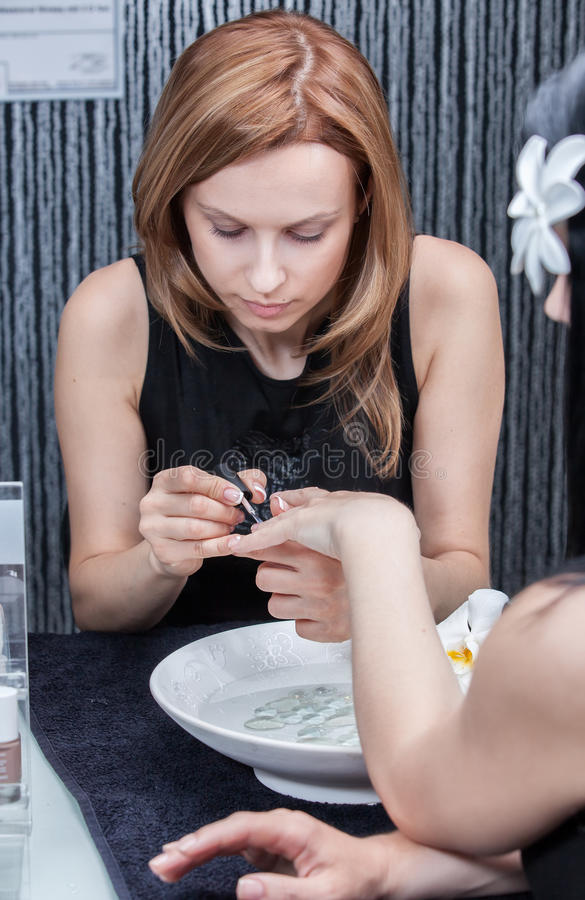Download Attractive Woman Having A Manicure At The Salon Stock Photo - Image of pamper, file: 25395254
