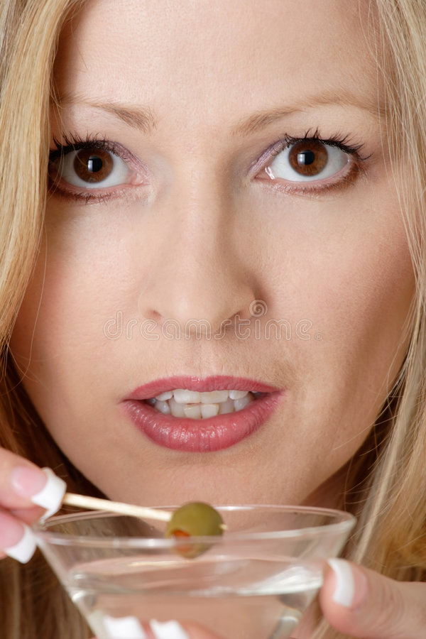 Attractive woman having a martini. Close up of an attractive woman having a martini stock photos