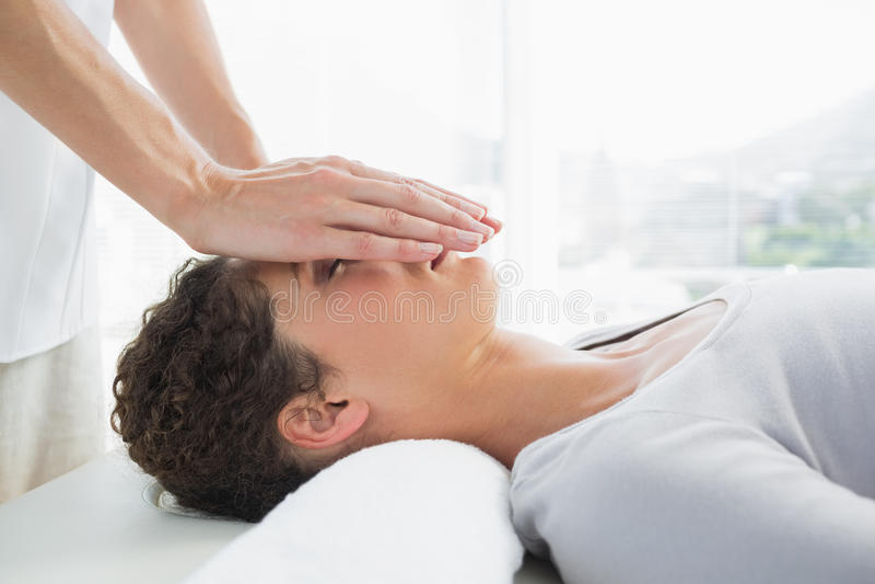 Attractive woman having reiki treatment stock image