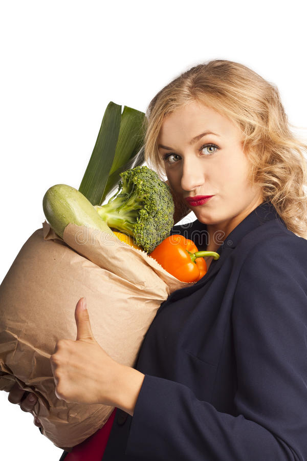 Download Attractive Woman Holding A Bag Of Useful Food Stock Photo - Image: 26559868