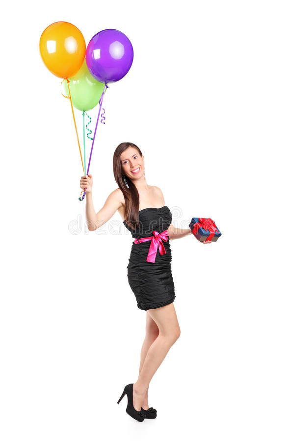 Attractive woman holding balloons and gift royalty free stock images
