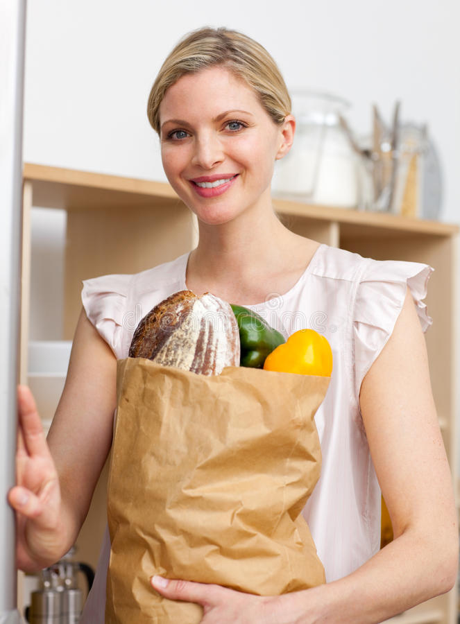 Download Attractive Woman Holding A Grocery Bag Stock Photo - Image: 12617584