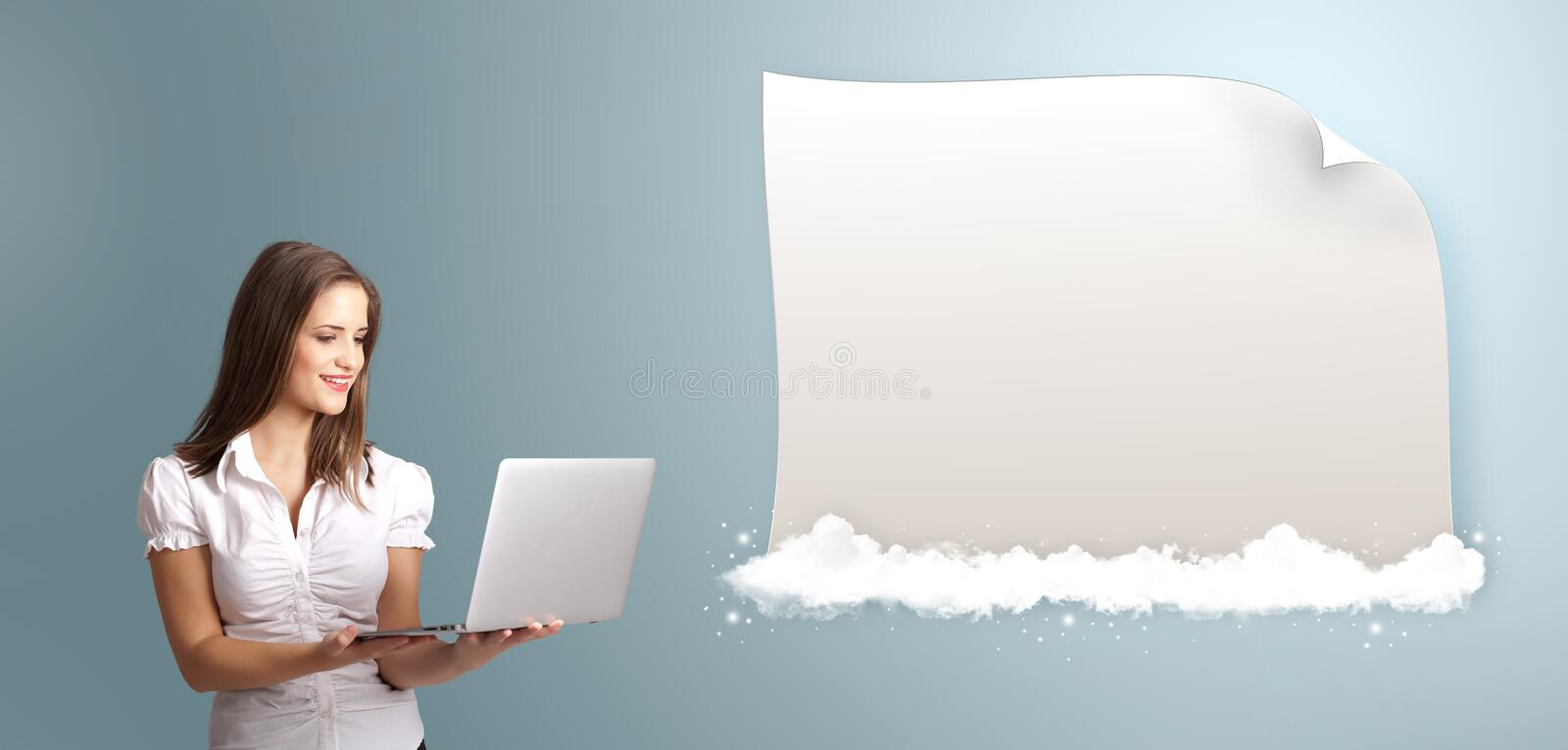 Attractive woman holding a laptop and presenting modern copy spa royalty free stock photo