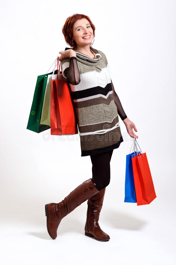 Download Attractive Woman Holding Shopping Bags Stock Photo - Image of bags, dress: 22353150
