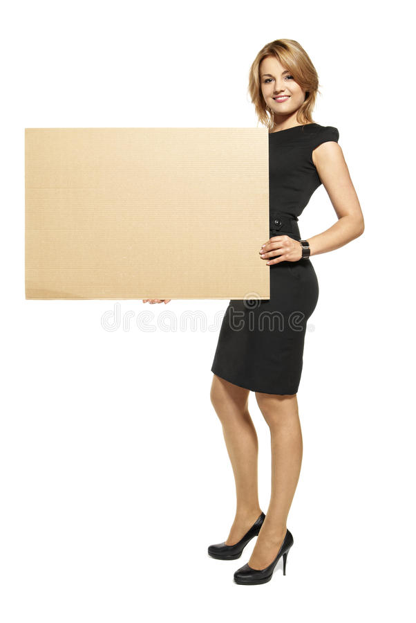 Attractive Woman Holding Up a Blank Sign royalty free stock photography