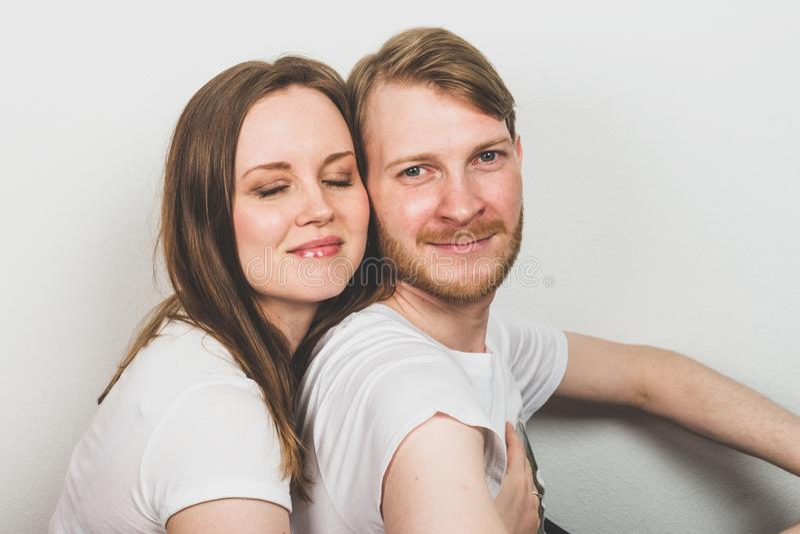 Attractive woman hugging bearded man stock photo