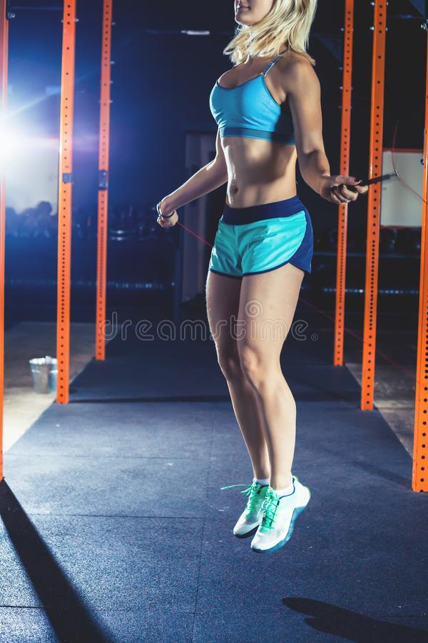 Attractive woman jumps with skipping rope. Workout exercise gym class. Active People Sport Workout Concept. Attractive woman jump with a skipping rope, exercises stock photos