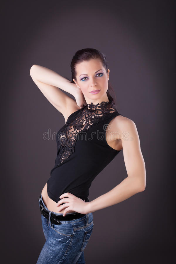 Attractive woman in lacy dress and jeans stock images