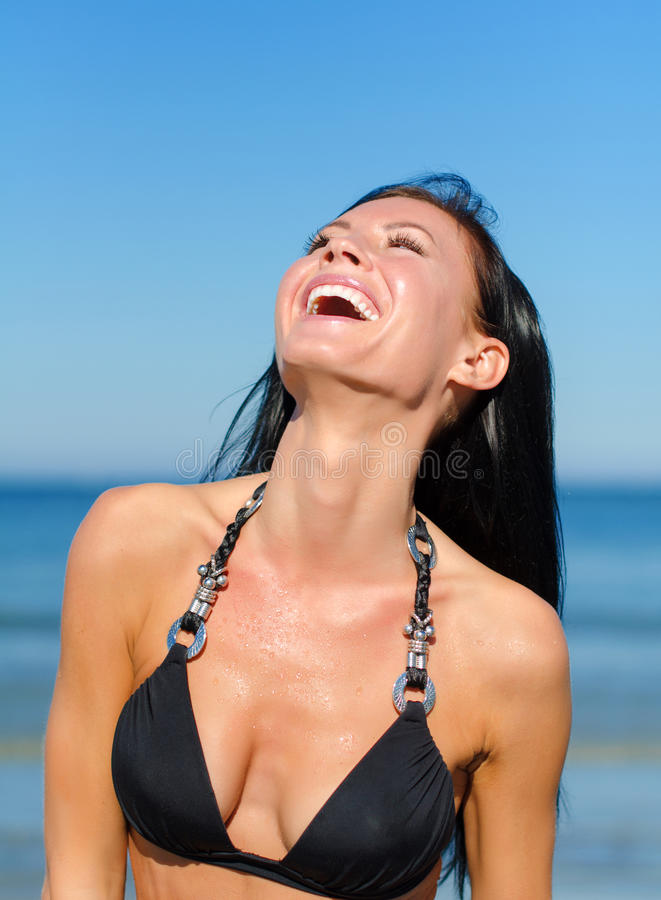 Attractive woman laughing. At the beach stock photos