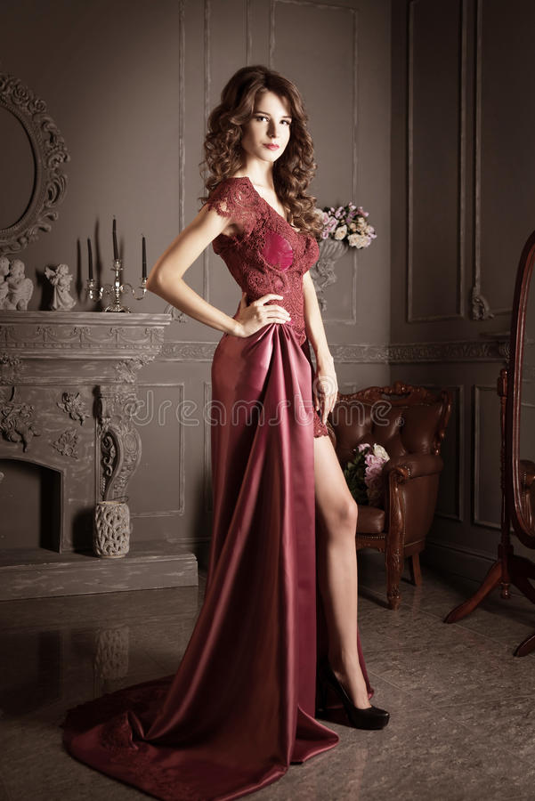 Attractive woman in long claret lace dress. Luxury. Vintage stock images