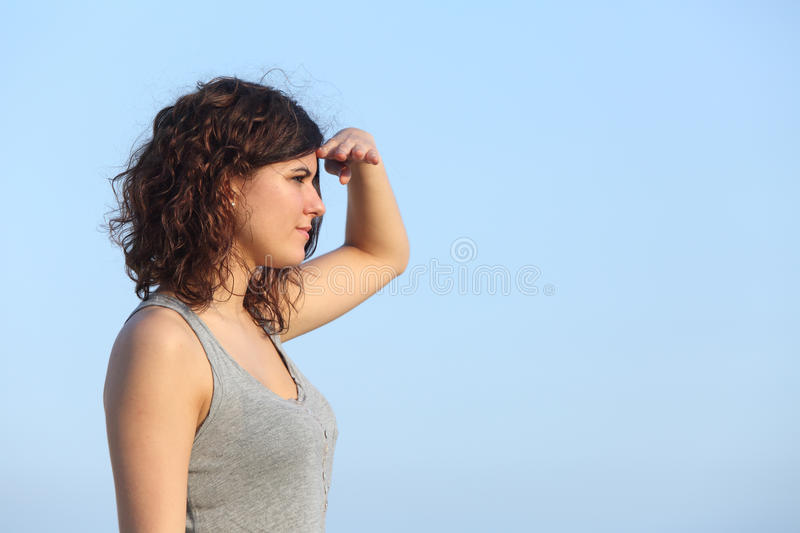 Download Attractive Woman Looking Ahead With The Hand In Forehead Stock Photo - Image: 32018498