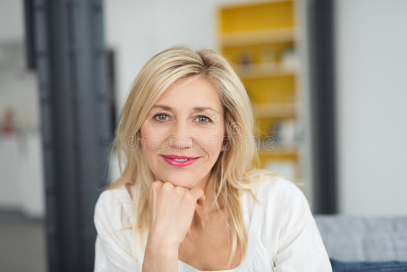 Attractive woman looking pensively at the camera royalty free stock photos