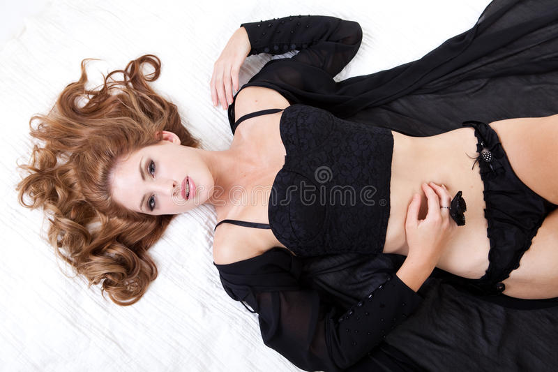 Attractive Woman Lying in Bed with Lingerie