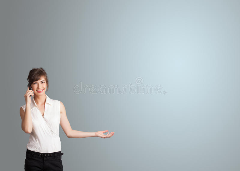 Attractive woman making phone call with copy space stock photography