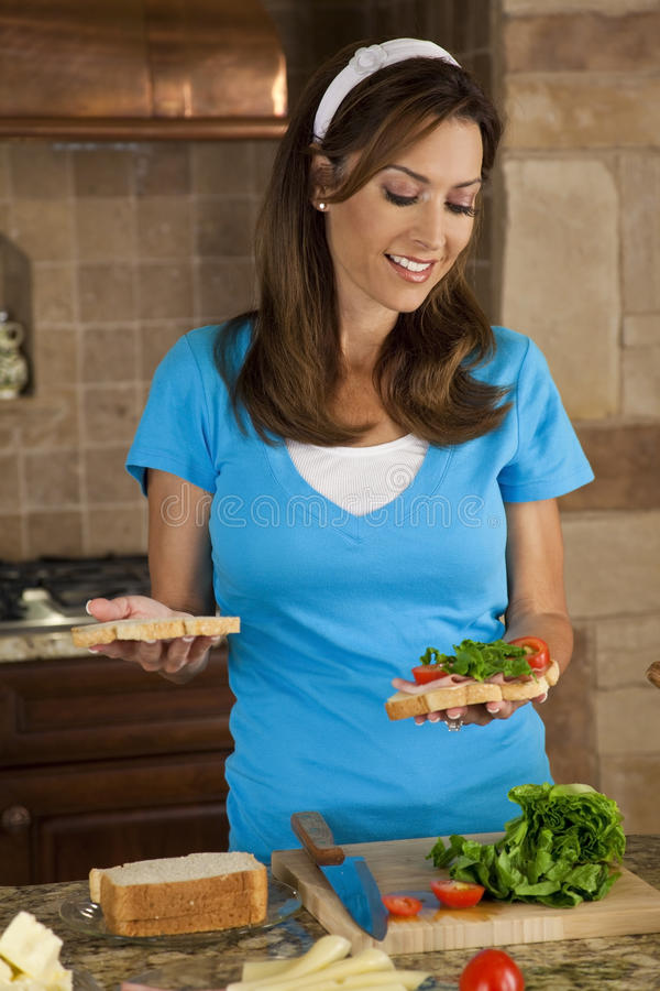 Download Attractive Woman Making Sandwiches In Home Kitchen Stock Photos - Image: 16488513