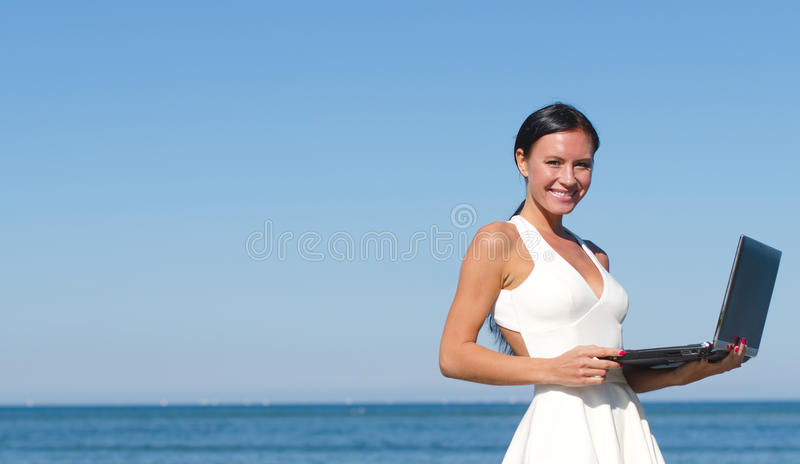 Download Attractive Woman With Notebook Stock Photo - Image of beach, happy: 34313920