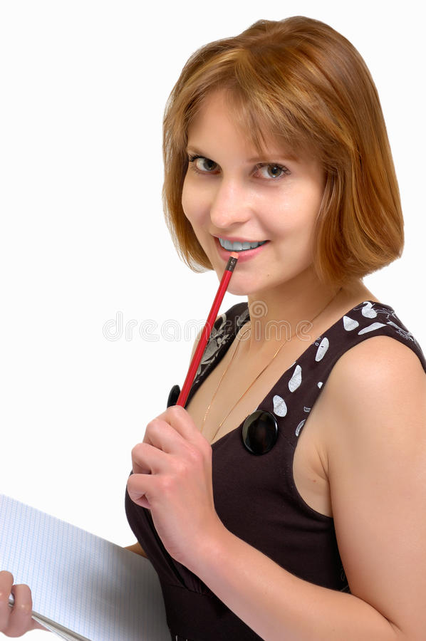 Attractive woman with a pencil and a notebook in h stock images