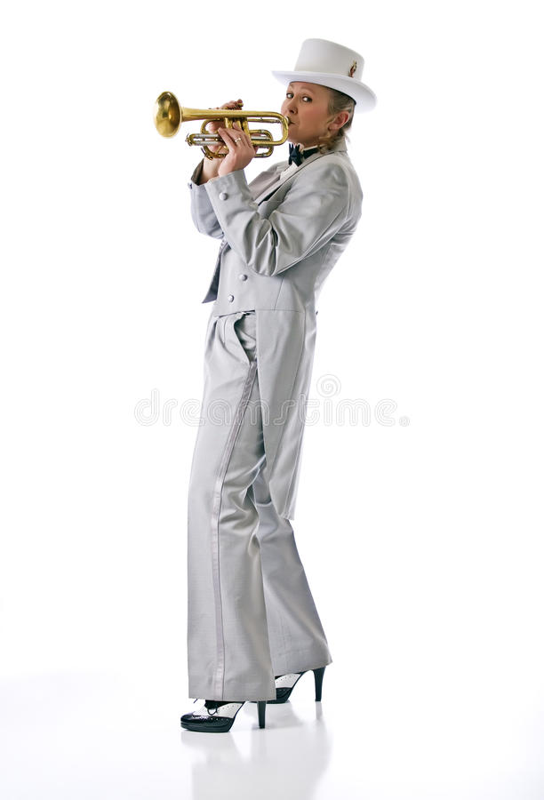 Attractive woman playing the trumpet royalty free stock image