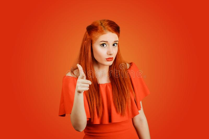 Attractive woman pointing her finger at you camera stock photos