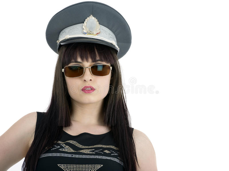Attractive woman in policeman cap and glasses royalty free stock photos