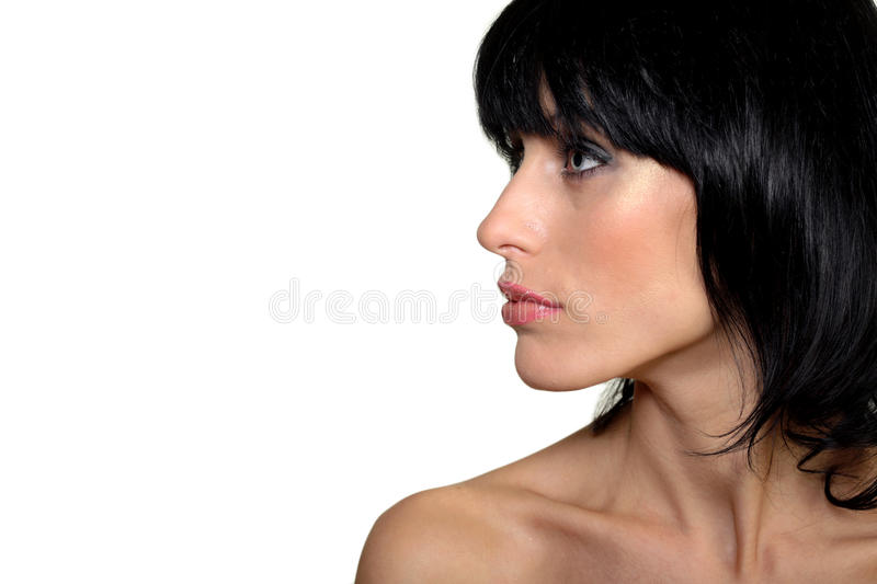 Attractive woman portrait looking on left, makeup stock images