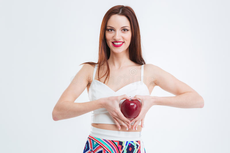 Attractive woman posing with red apple stock images