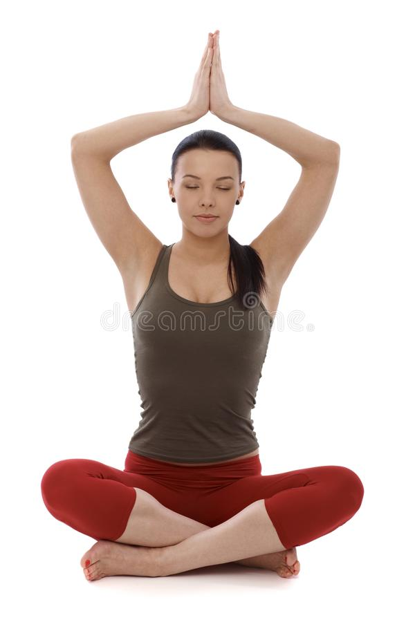 Attractive woman practicing yoga eyes closed