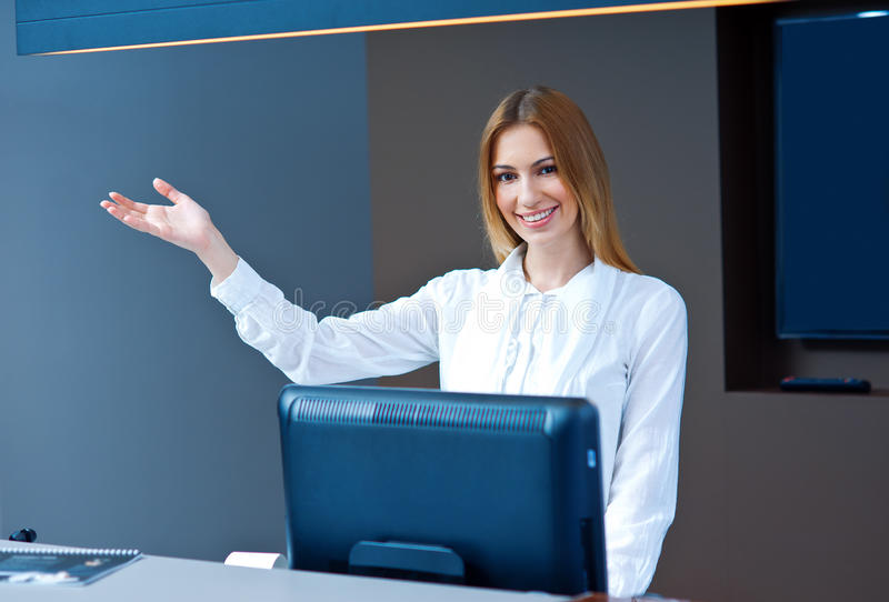 Download Attractive Woman Receptionist Making Friendly Gesture Stock Image - Image: 30617001