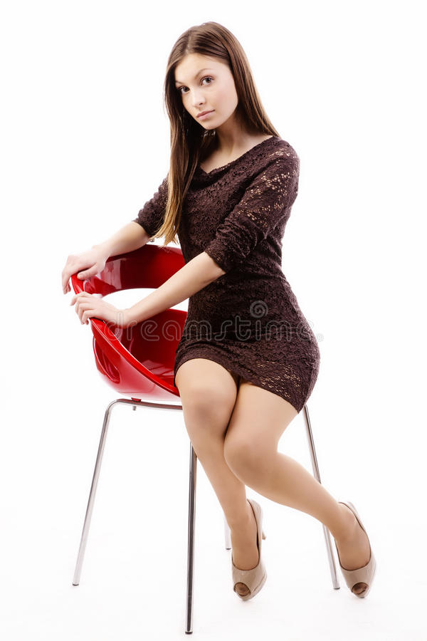 Attractive woman in red chair