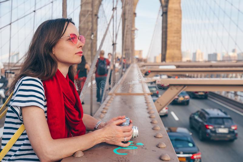 Attractive woman with red scarf on Brooklyn Bridge. In New York royalty free stock photos