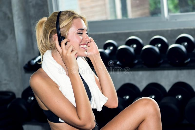 Attractive woman relax and listen the music at the gym stock photo