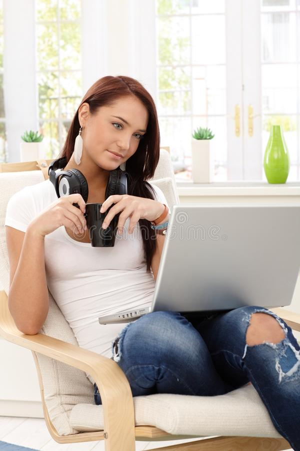 Attractive woman relaxing with laptop stock images
