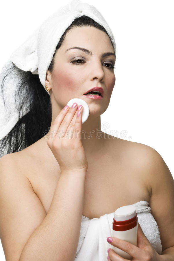 Attractive woman removing make-up royalty free stock photos