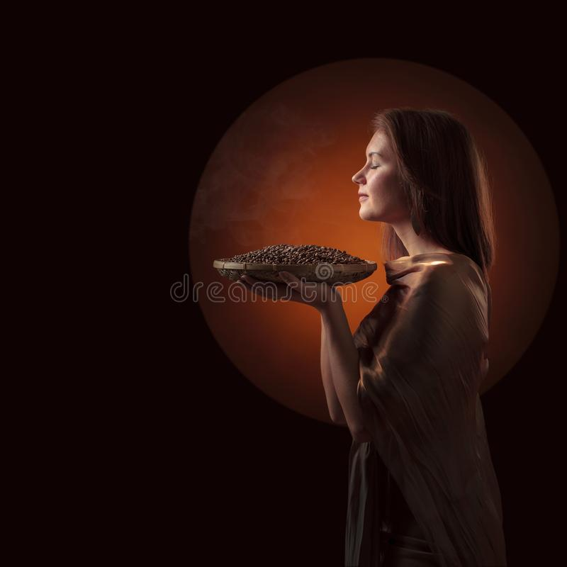 Attractive woman with roasted coffee beans in basket on a dark background royalty free stock photos