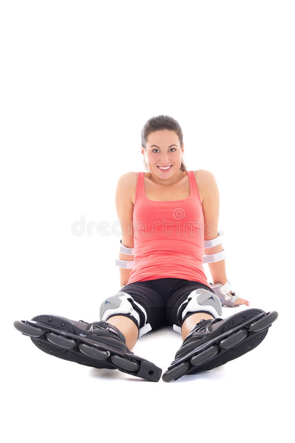Attractive woman in roller skates sitting isolated on white back