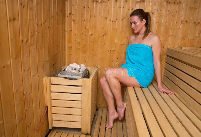 Attractive woman in sauna stock photo