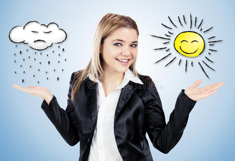 Attractive woman showing weather with hands royalty free stock photo