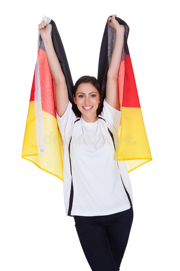 Attractive Woman Shows Flag Of Germany stock photography