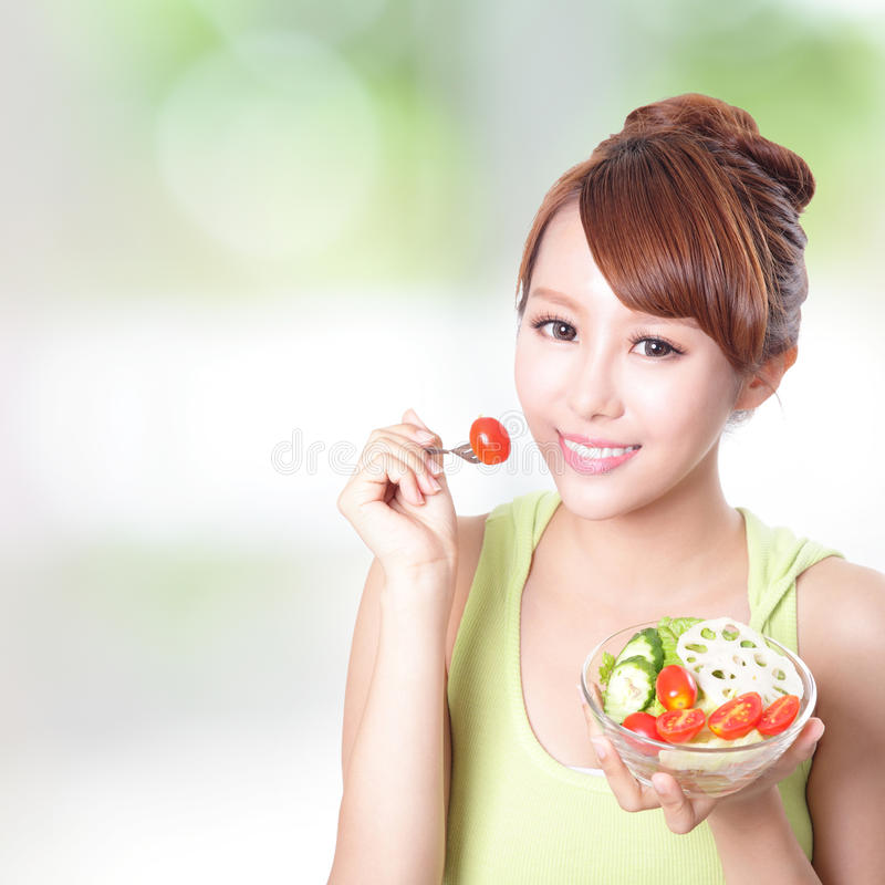 Download Attractive Woman Smile Eating Salad Stock Photo - Image: 34055982
