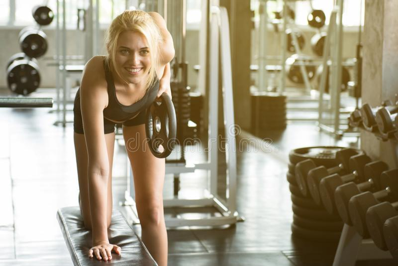 An attractive woman smile and training with dumbbell royalty free stock images
