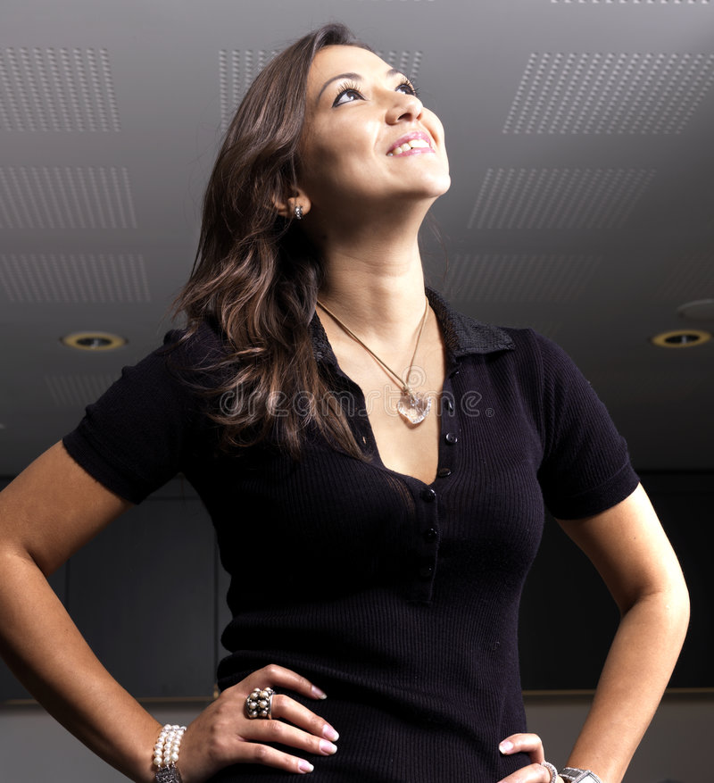 Attractive woman smiling, dark background stock images